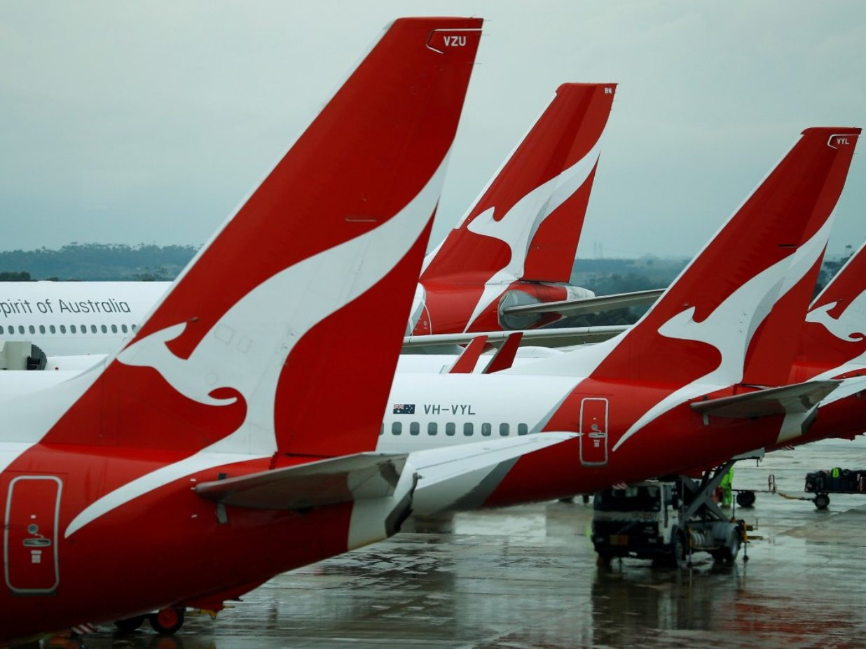 Qantas cuts international routes